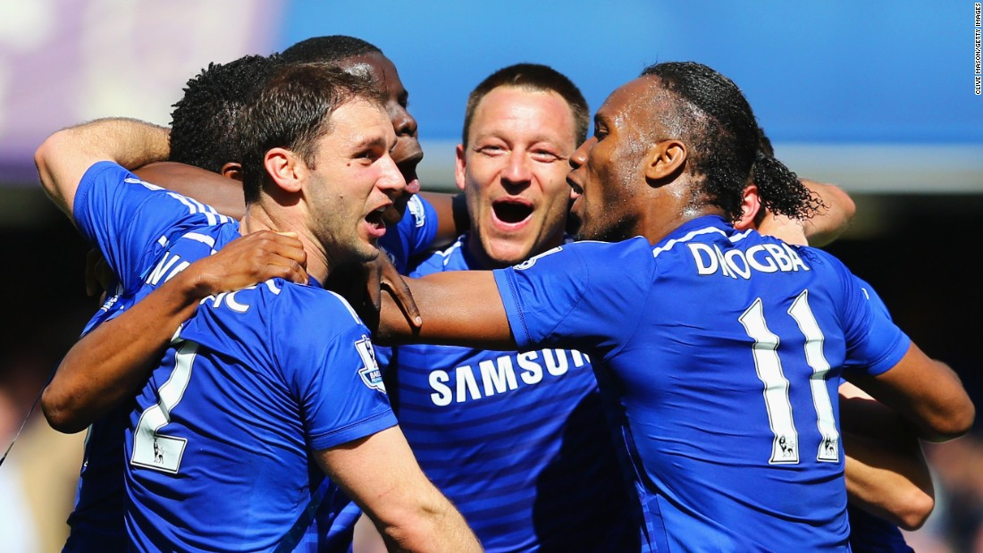 Branislav Ivanovic, from left, John Terry and Didier Drogba of Chelsea celebrate winning the Premier League title after their match against Crystal Palace in London on Sunday, May 3.