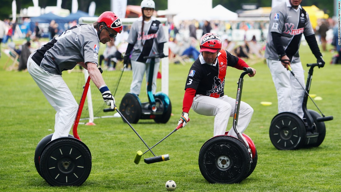 Players compete in a Segway polo match on Friday, May 1, in Cologne, Germany.