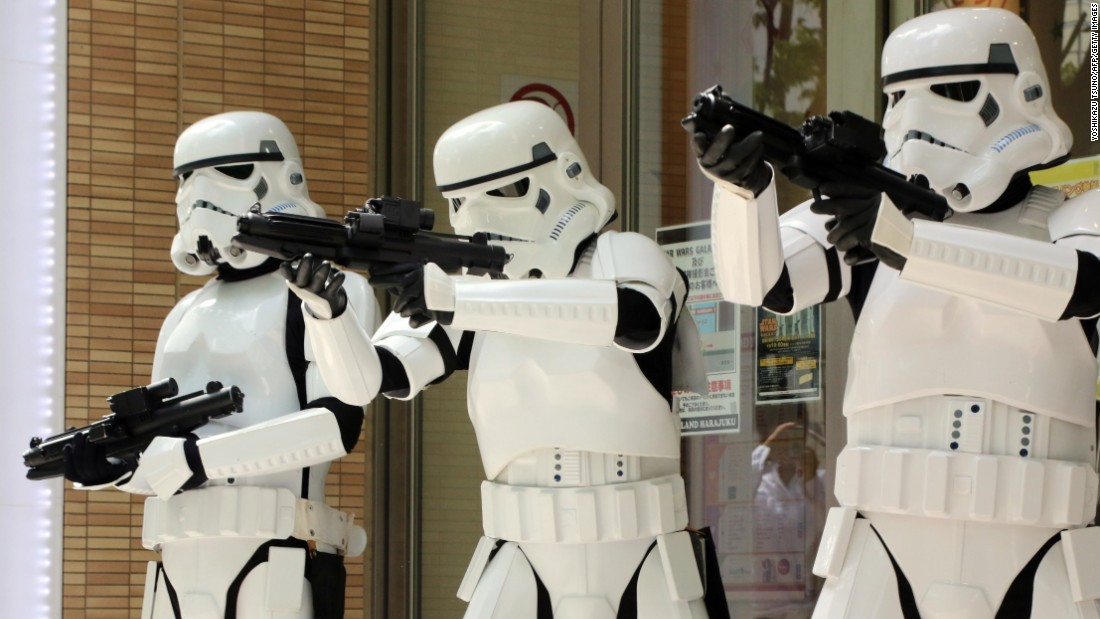 "People pose as Stormtroopers at a toy shop to promote ""Star Wars"" goods in Tokyo on May 4. May 4 is called ""Star Wars Day"" by fans of the film series, because the famous phrase ""May the Force be with you"" in the movies sounds like ""May the 4th be with you."""