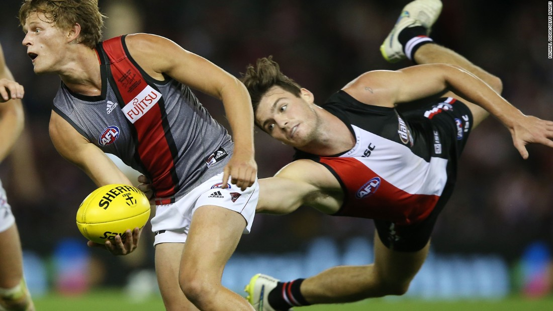 St. Kilda Saints player Dylan Roberton tackles Martin Gleeson of the Essendon Bombers during an Australian rules football match on Sunday, May 3, in Melbourne.