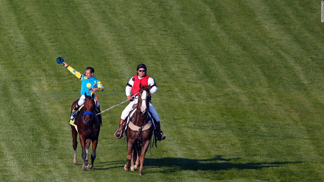 Jockey Victor Espinoza celebrates after riding American Pharaoh to victory in the Kentucky Derby horse race on Saturday, May 2, in Louisville, Kentucky.