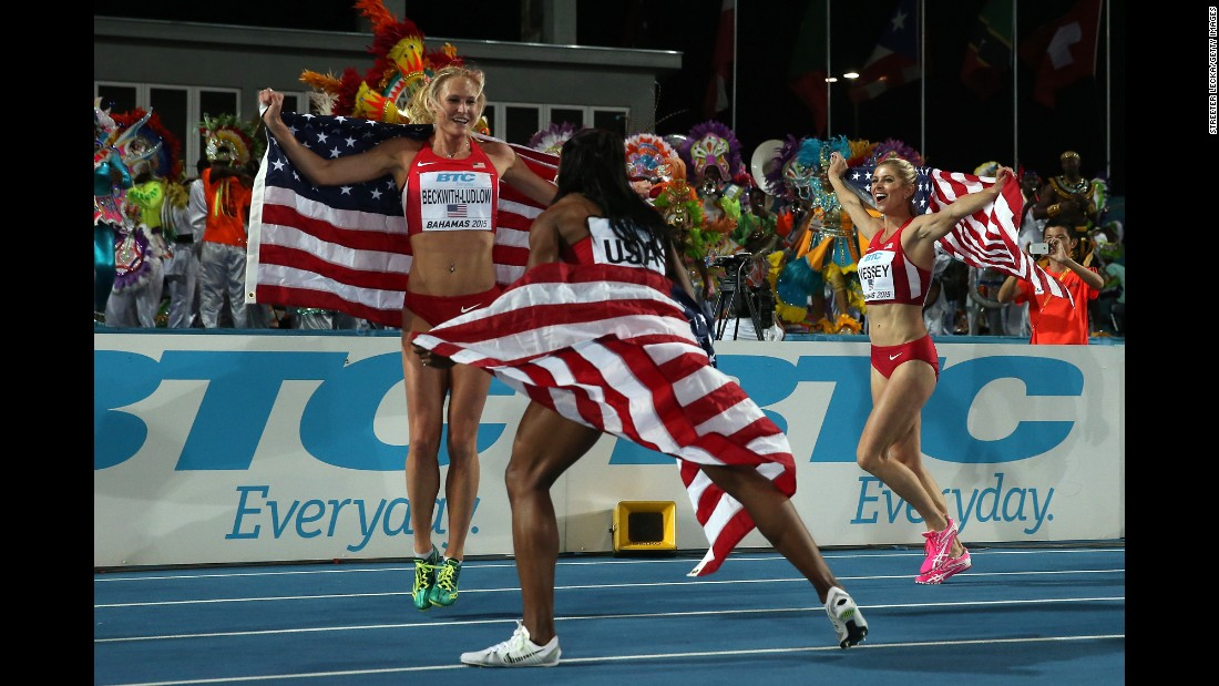 American athletes Maggie Vessey, from left, Chanelle Price and Molly Beckwith-Ludlow celebrate after winning the women's 4 x 800 meters final during the IAAF/BTC World Relays on Sunday, May 3, in Nassau, Bahamas.