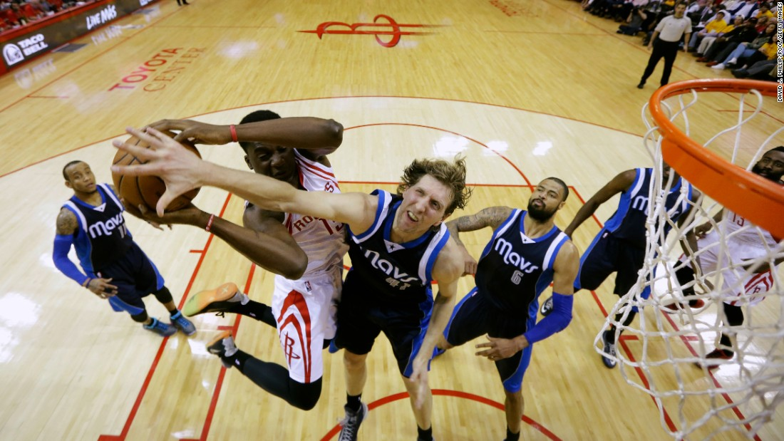 Dallas Mavericks forward Dirk Nowitzki defends against Clint Capela of the Houston Rockets on Tuesday, April 28, during the 2015 NBA Playoffs in Houston.