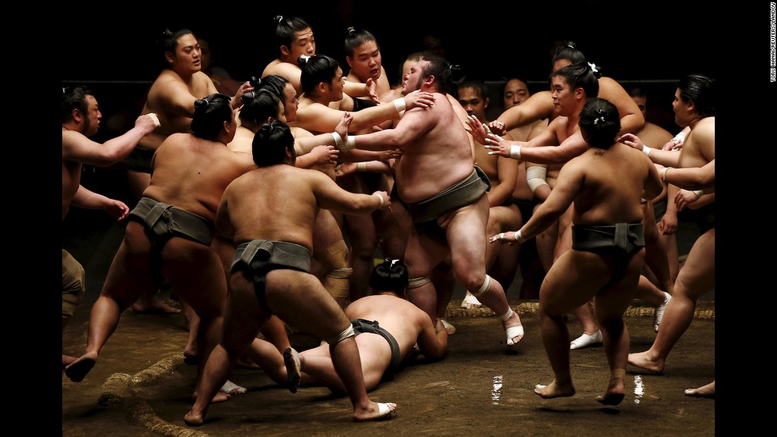 Sumo wrestlers participate in a rowdy training session in Tokyo on Saturday, May 2, ahead of the May Grand Sumo Tournament.