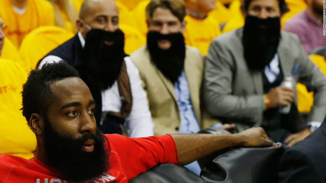 Bearded Houston Rockets fans wait behind Rockets player James Harden before the start of the game against the Dallas Mavericks in Houston on Tuesday, April 28, during the quarterfinals of the 2015 NBA Playoffs.