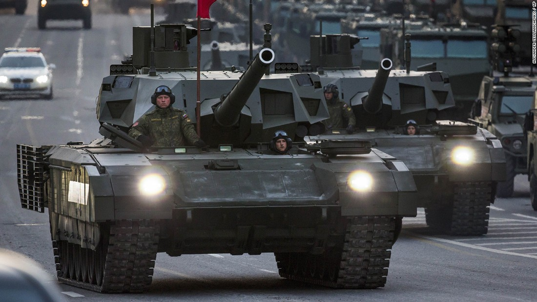 New Russian military vehicles including the new Russian T-14 Armata tank, foreground, make their way to Red Square on Monday during a rehearsal for the Victory Day military parade.