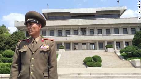 Junior Lt. Colonel Nam Dong Ho stands in front of the North Korean side of the DMZ, the heavily fortified border between North and South Korea.