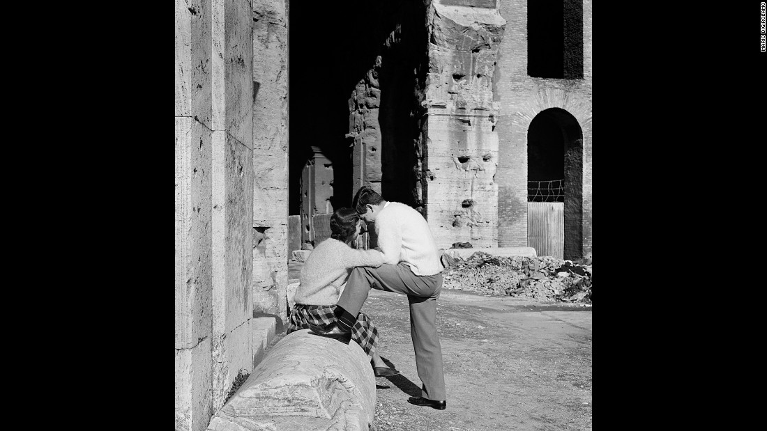 Two young lovers share an intimate moment at the Colosseum in Rome in 1956.