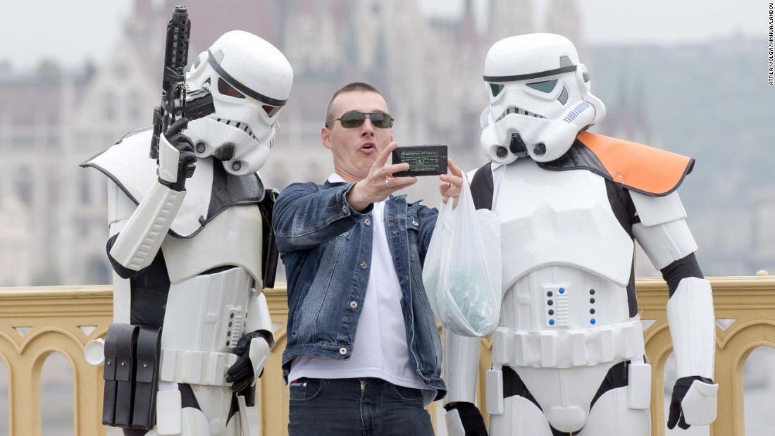 """Star Wars"" fans dress as their favorite movie characters on Sunday, May 3, in Budapest. <a href=""http://www.cnn.com/2015/05/03/entertainment/gallery/star-wars-day-2015/index.html"">""Star Wars Day""</a> is observed around the world on May 4, with fans saying ""May the Fourth be with you,"" inspired by the Jedi mantra ""May the Force be with you."""
