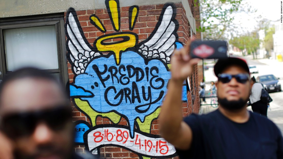 "A man takes a selfie on Saturday, May 2, in front of a mural that was painted at the site of Freddie Gray's arrest in Baltimore, as people prepare to march to City Hall. The death of Grey in police custody <a href=""http://www.cnn.com/2015/04/23/us/gallery/freddie-gray-protest/index.html"">sparked protests in Baltimore</a> and <a href=""http://www.cnn.com/2015/04/30/us/gallery/freddie-gray-protests-across-us/index.html"">across the country</a>. Six police officers were charged May 1 with felonies in connection to his death."