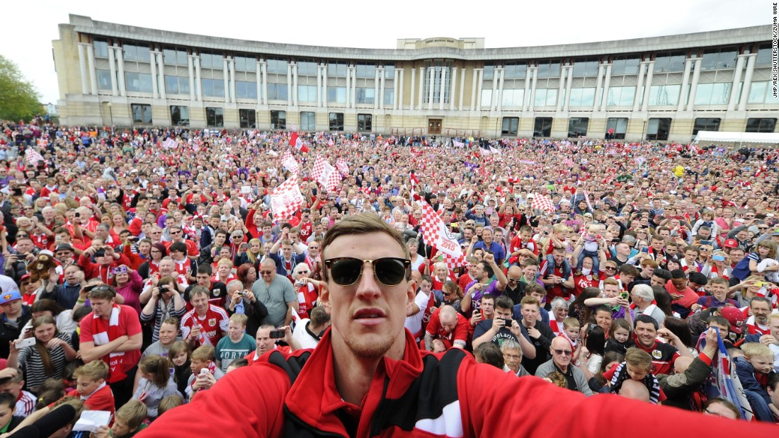 Bristol City soccer player Aden Flint takes a selfie in front of fans gathered at the amphitheater in Bristol on Monday, May 4.