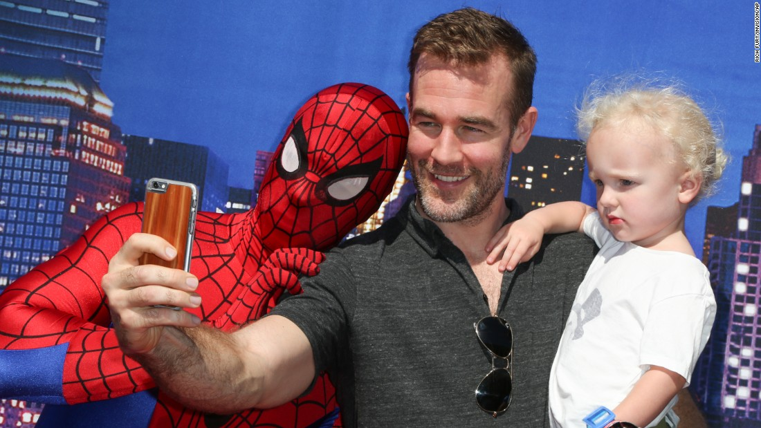 "Actor James Van Der Beek and his son Joshua take a photo with the Spiderman character at the premiere of ""Marvel Universe LIVE!"" in Inglewood, California, on Saturday, May 2."