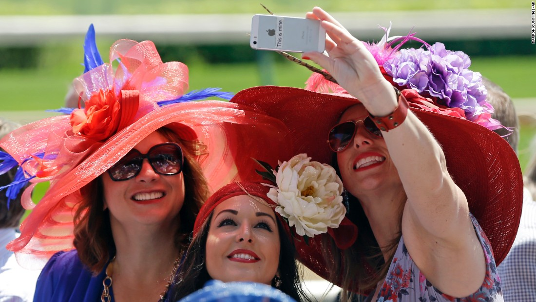 "Fans take a selfie before the Kentucky Oaks horse race in Louisville, Kentucky, on Friday, May 1. The race is held annually at Churchill Downs on the day before the <a href=""http://www.cnn.com/2015/05/02/us/gallery/kentucky-derby-hats-2015/index.html"">Kentucky Derby</a>."