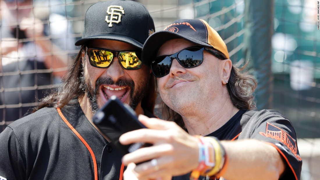 Metallica musicians, drummer Lars Ulrich, right, and bassist Robert Trujillo, take a selfie before a baseball game on Saturday, May 2, between the San Francisco Giants and Los Angeles Angels in San Francisco.