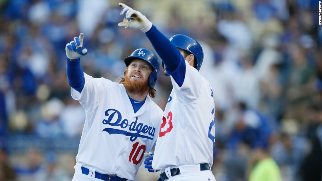 "Los Angeles Dodgers player Justin Turner, left, celebrates his solo home run against the Arizona Diamondbacks by pretending to take a selfie with teammate Adrian Gonzalez on Saturday, May 2, in Los Angeles. <a href=""http://www.cnn.com/2015/04/29/living/gallery/selfies-look-at-me-0429/index.html"" target=""_blank"">See 20 selfies from last week.</a>"