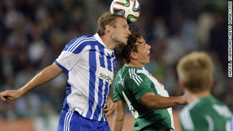 HJK became the first Finnish club to play in the Europa League group stages. HJK's Markus Heikkinen (left) is pictured.