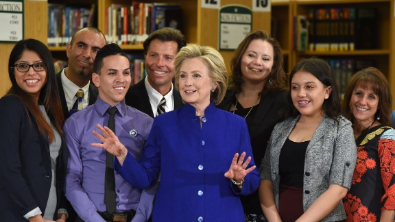 Democratic presidential candidate and former U.S. Secretary of State Hillary Clinton (C) poses with students and faculty after speaking at Rancho High School on May 5, 2015 in Las Vegas, Nevada. Clinton said that any immigration reform would need to include a path to