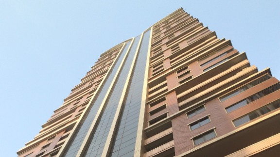 The outside of the faculty apartment tower is clean and modern.
