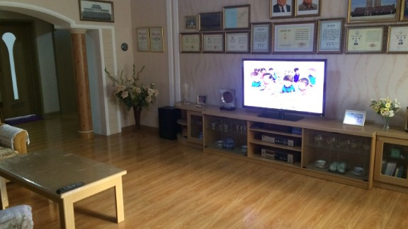 The apartment has modern electronics including a new flat screen television.