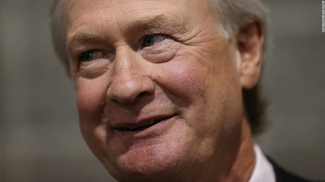 Chafee answers questions from reporters after speaking at the South Carolina Democratic Party state convention on April 25.