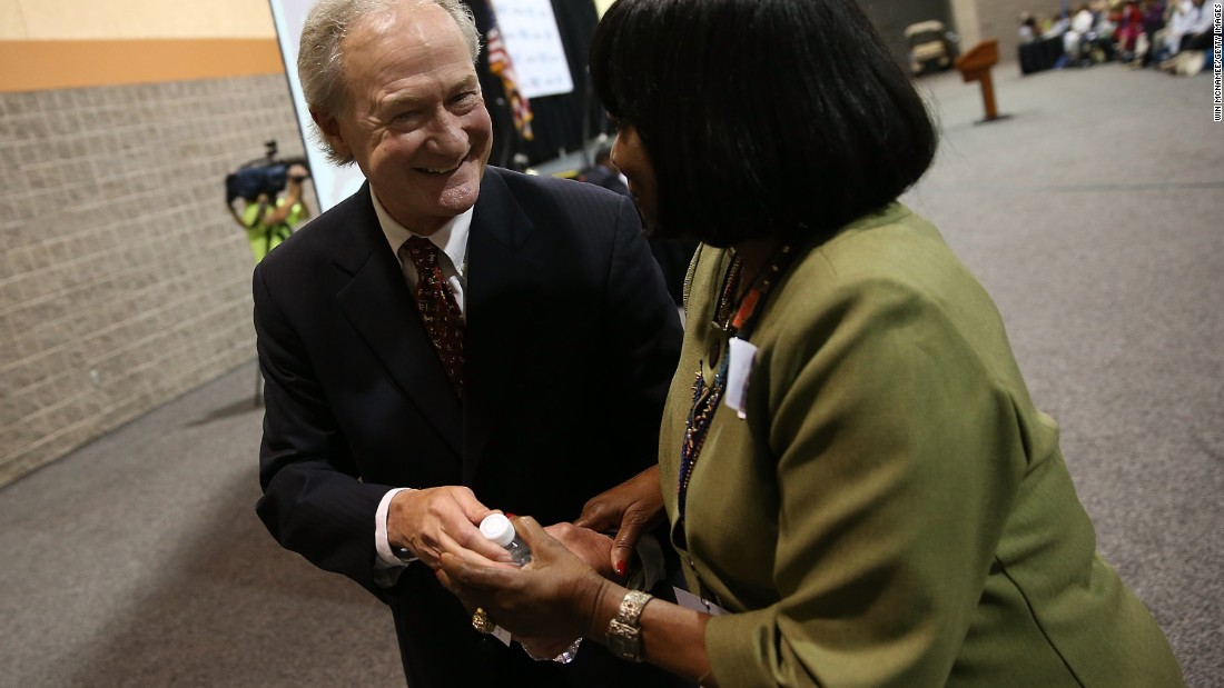 Chafee greets a member of the audience after speaking at the South Carolina Democratic Party state convention on April 25.