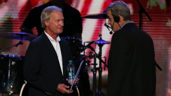 Chafee, left, then governor of Rhode Island, stands on stage with stage manager David Cove during Day One of the Democratic National Convention in Charlotte, North Carolina, on September 4, 2012.