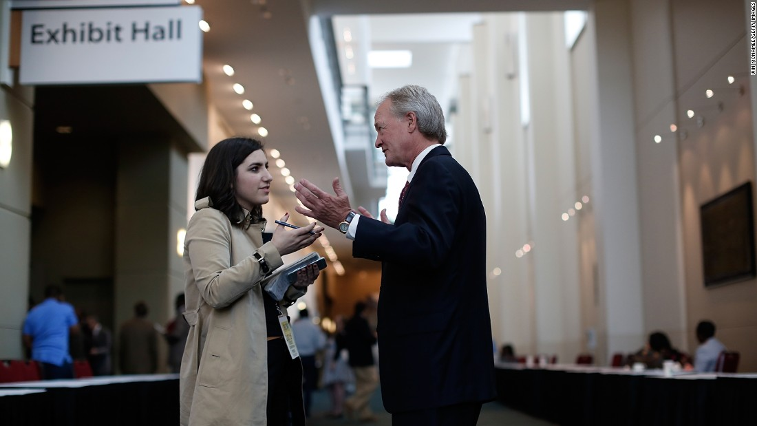 Chafee answers questions from a reporter after speaking at the South Carolina Democratic Party state convention on April 25.
