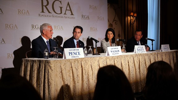 Pence, from left, Wisconsin Gov. Scott Walker, South Carolina Gov. Nikki Haley and New Jersey Gov. Chris Christie attend a news briefing during the Republican Governors Association's quarterly meeting on May 21, 2014, in New York.