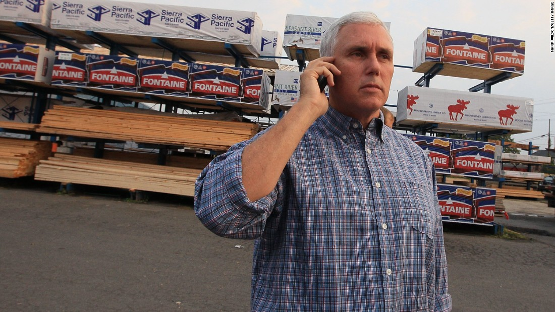 In front of the Tart Lumber store in Sterling, Virginia, Pence talks on his cell phone before House Republicans unveiled their proposed governing agenda for the 111th Congress on September 23, 2010.