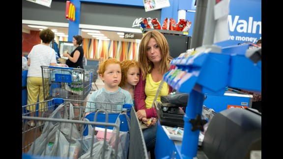 Pencils, erasers and binders are scanned through the checkout counter as the family does some back-to-school shooping in August. Cheryl is wearing a wig. Despite how she felt from the chemotherapy, she wouldn