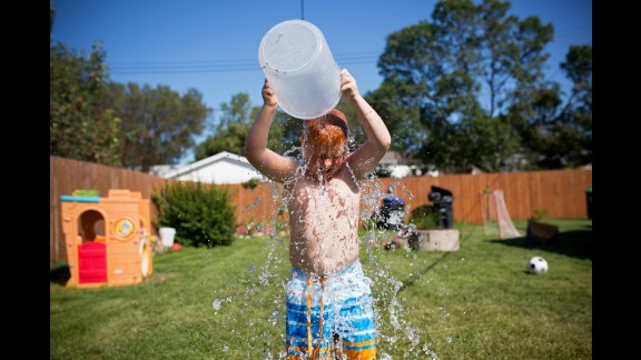 Colin takes the Ice Bucket Challenge on a hot August day to raise awareness of ALS. Moments later, Emily also completed the challenge, and both of the children doused their grandma while their mom recorded video. Cheryl