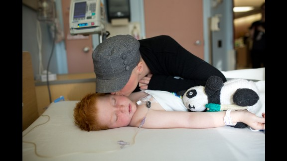 Colin gets a kiss on the cheek as he wakes up from a medical procedure in October. He goes to Winnipeg once a month for chemotherapy treatment, and he must undergo a lumbar puncture every three months to confirm the cancer hasn