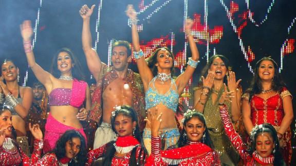 In 2003, Khan performs with MTV VJs Ramona, Sophia, Malaika, Anusha and Shenaz during the Inaugural MTV IMMIES in Mumbai, India.