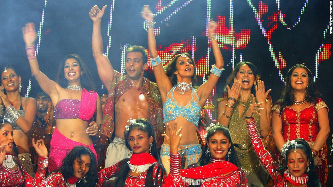In 2003, Khan performs with MTV VJs Ramona, Sophia, Malaika, Anusha and Shenaz during the Inaugural MTV IMMIES in Mumbai, India.