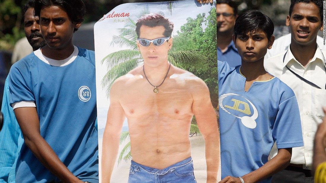 Khan fans carry his poster outside the actor's residence in Mumbai in 2007. They were there in support of the actor who was facing five years in jail for killing a rare gazelle.