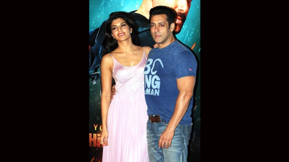 """Indian Bollywood actors Jacqueline Fernandez, left, and Salman Khan pose for a photograph during a promotional event for the Hindi film """"Kick"""" in Mumbai, India."""