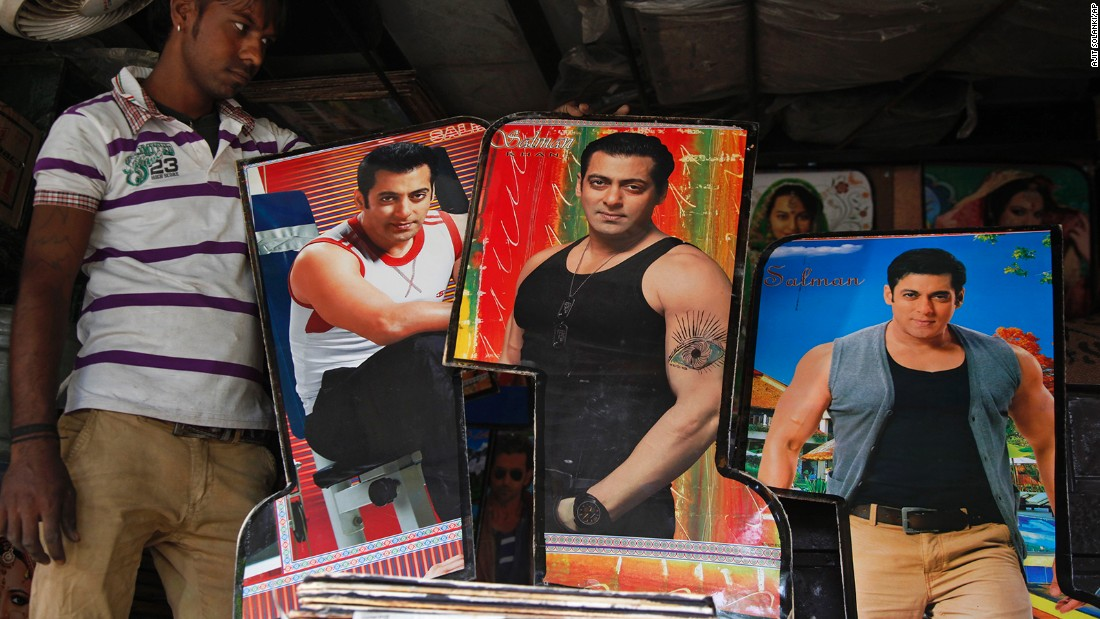An Indian man displays photographs of Bollywood actor Salman Khan, custom made for decorating the interiors of auto-rickshaws in Ahmadabad, India, in May 2015.