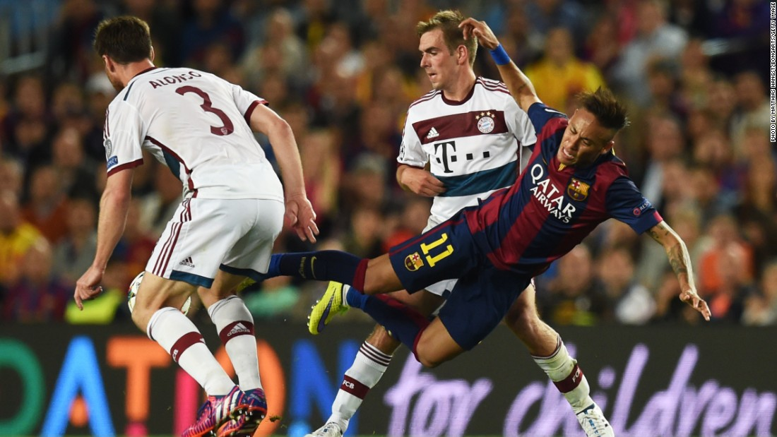 Neymar of Barcelona is tackled by Xabi Alonso of Bayern Muenchen during the UEFA Champions League Semi Final, first leg match between FC Barcelona and FC Bayern Muenchen at Camp Nou on May 6, 2015 in Barcelona, Spain.