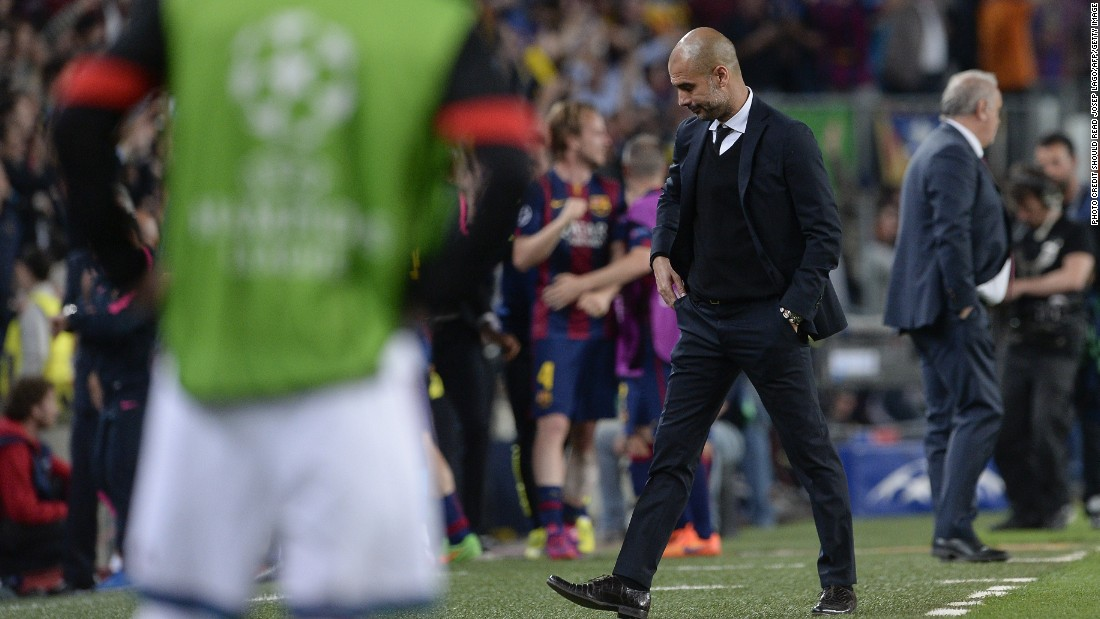 Bayern Munich's Spanish head coach Pep Guardiola looks down during the UEFA Champions League football match FC Barcelona vs FC Bayern Muenchen at the Camp Nou stadium in Barcelona on May 6, 2015.