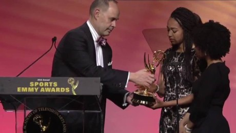 orig ernie johnson gives emmy to stuart scott's daughters_00012514.jpg