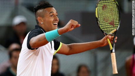 Nick Kyrgios celebrates match point against Swiss tennis great Roger Federer in their second-round match in Madrid.