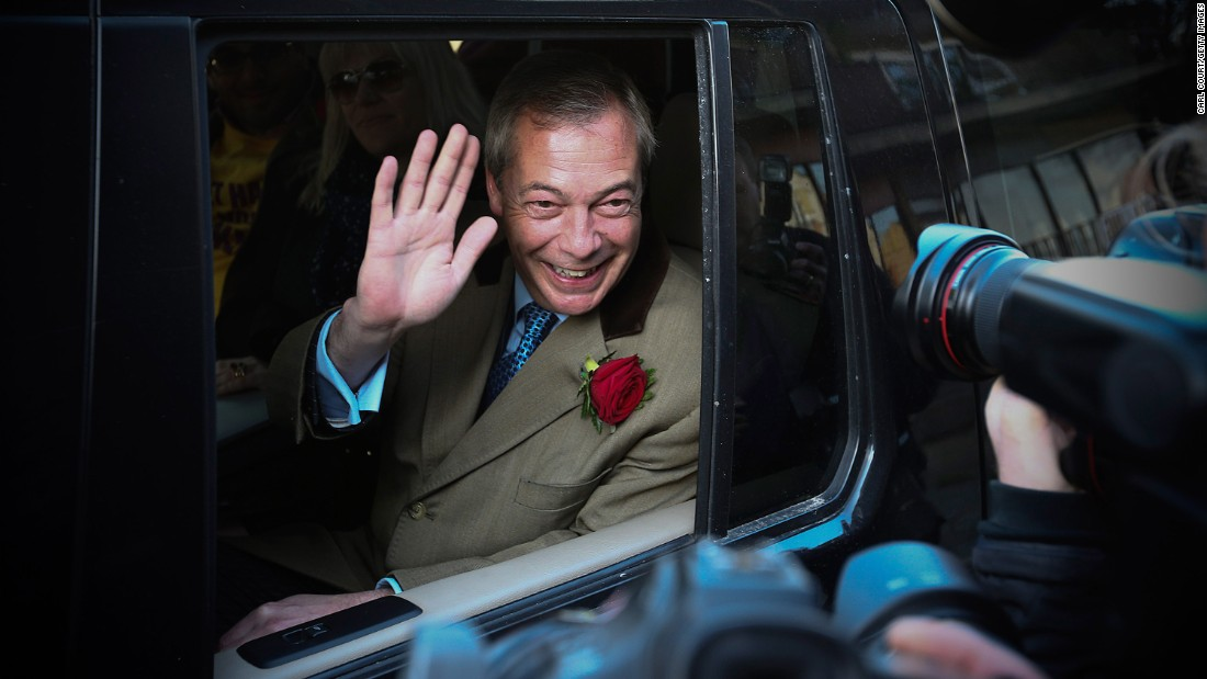 Nigel Farage, leader of the UK Independence Party, waves from his car after casting his vote in Ramsgate, Kent, England.