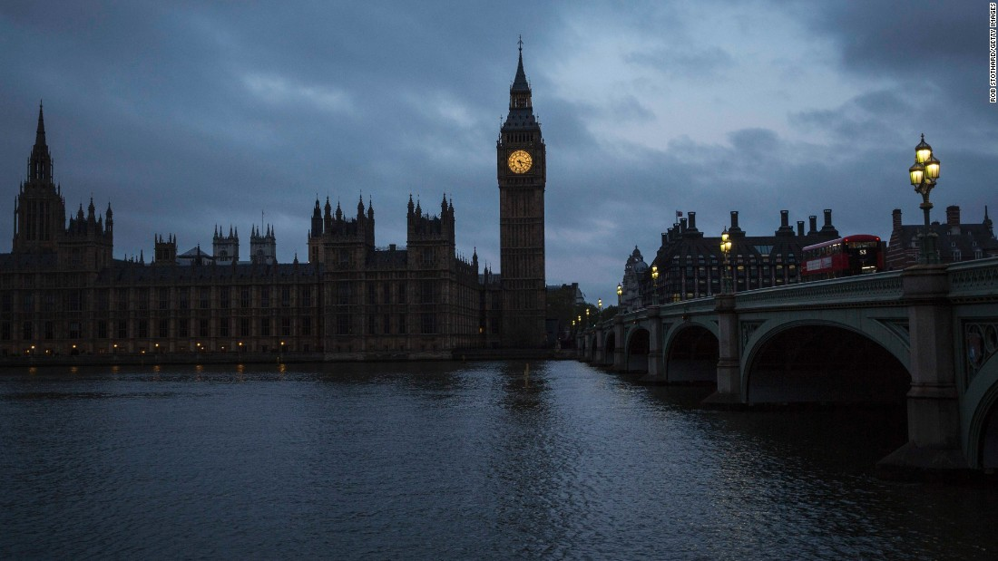 Clouds roll over Big Ben and the Houses of Parliament in London early Thursday, May 7.