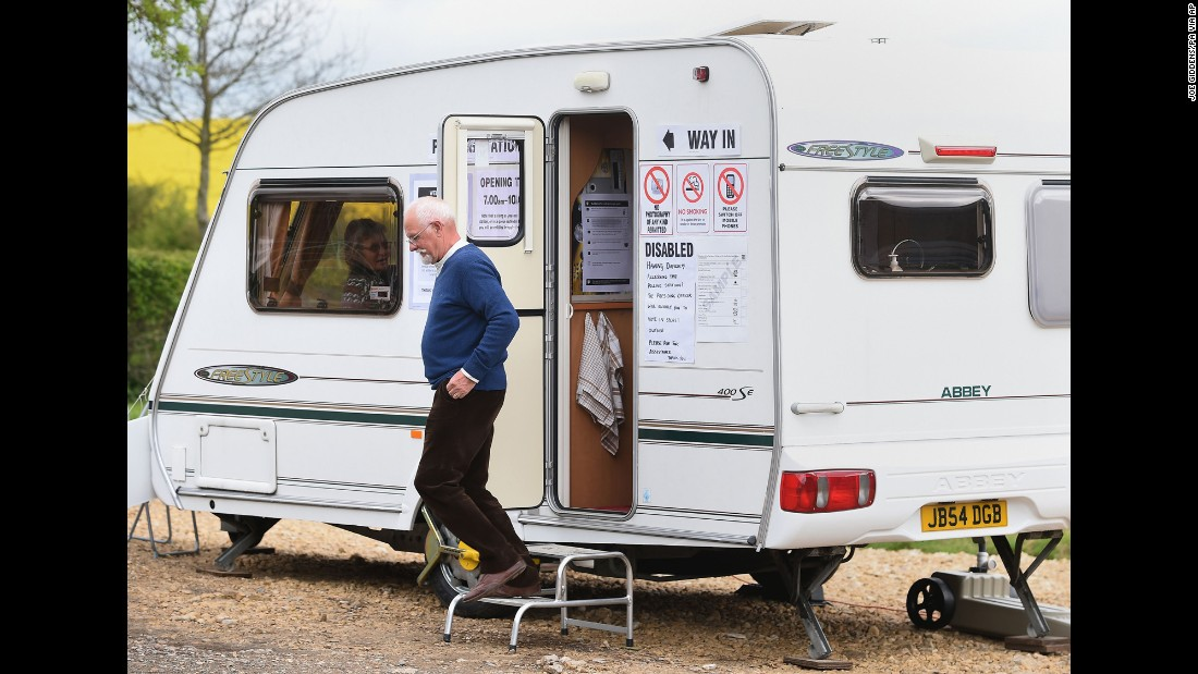 A man leaves after casting his vote in a trailer in Garthorpe, England.