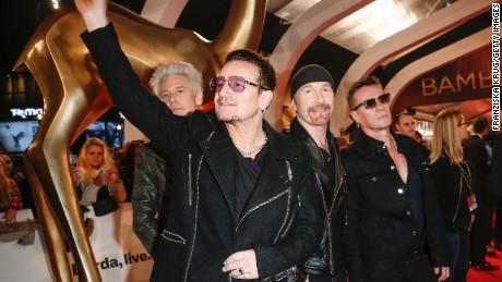 Bono waves as he and the rest of U2 -- Adam Clayton, The Edge and Larry Mullen Jr. -- arrive at an awards show in Berlin in November.