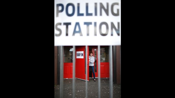 A woman leaves a polling station in West Belfast, Northern Ireland.