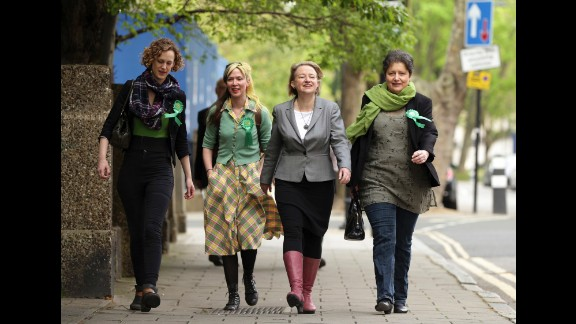 Green Party leader Natalie Bennett, second from right, arrives to vote in London.