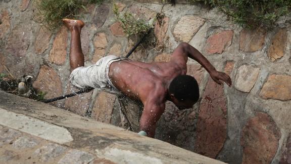Niyonzima falls in a sewer drain.