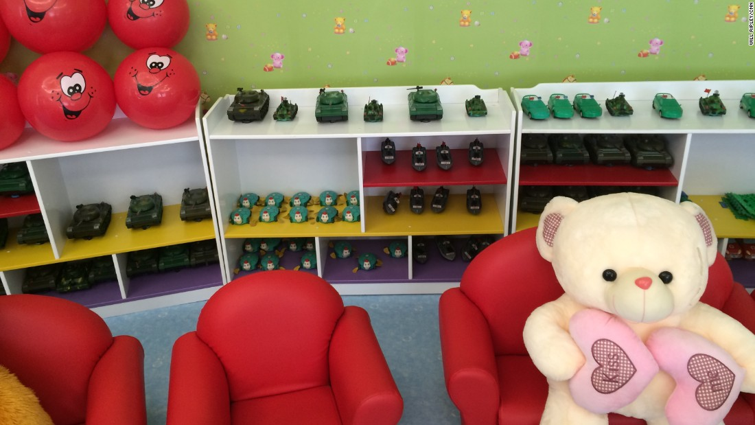 Toy tanks and large teddy bears are available in the playroom at the Pyongyang orphanage.