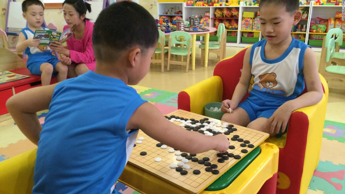 Young boys at a Pyongyang orphanage play a game of Go, a popular board game in Korea that originated in ancient China.